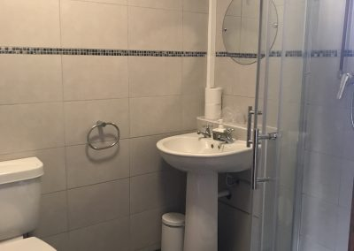 Bathroom of apartment 5 showing shower and handbasin