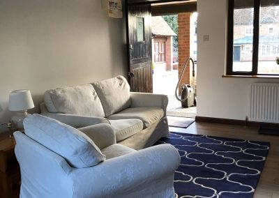Single and 2 seater sofa with blue floor rug